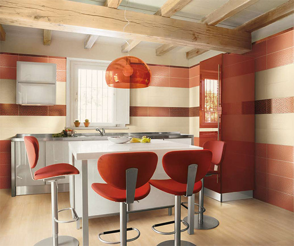 a bright and cool red and white kitchen with tiled walls and neutral cabients and a white kitchen island is wow