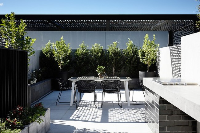 Contemporary townhouse with laconic and clean lined for Courtyard landscape design melbourne
