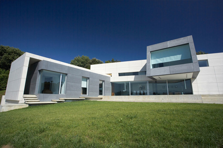 Contemporary style concrete house santander house by a for Modern looking houses