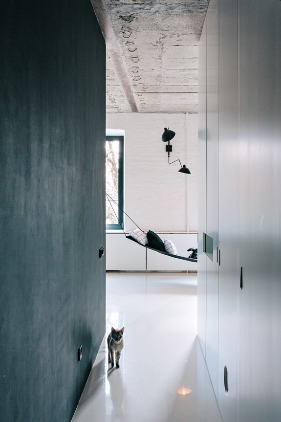 Contrasting Minimalist Apartment With A Black Steel Window Wall