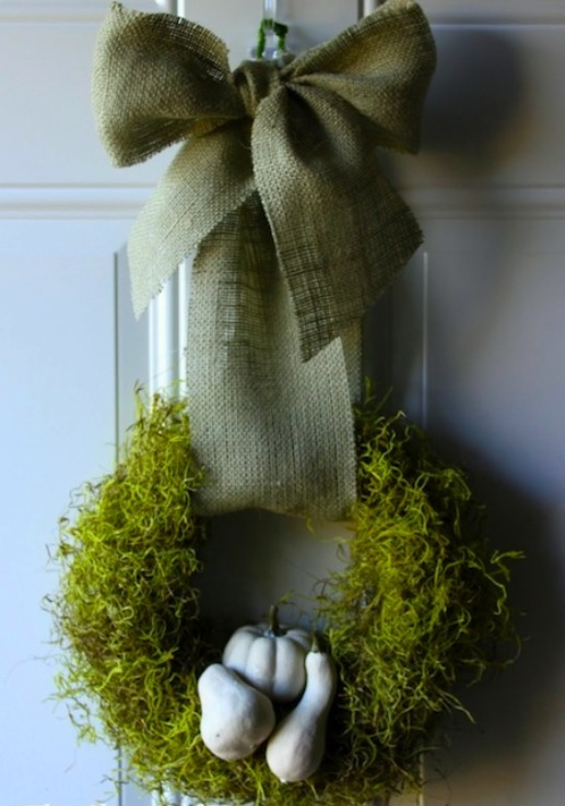 an all-natural Thanksgiving wreath of moss, gourds and with a large green bow on top is a gorgeous idea to rock