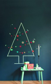 a simple Christmas tree made with tape on the wall, some pompom and star garlands will give a holiday feel to the room