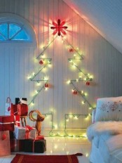 a bright and shiny Christmas tree of green lights and red ornaments and stacks of gifts on the floor will make your kids' room very festive