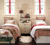 red ribbons with stars hanging on the windows and bright printed holiday bedding for Christmas decor