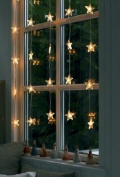 cute star garlands hanging down on the window are amazing for adding a slight festive feel to the room, whether it's a kids' or any other one