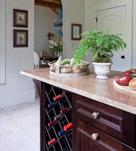 a wine storage unit built into a usual kitchen cabinet is a simple and cool idea if you don't have many bottles