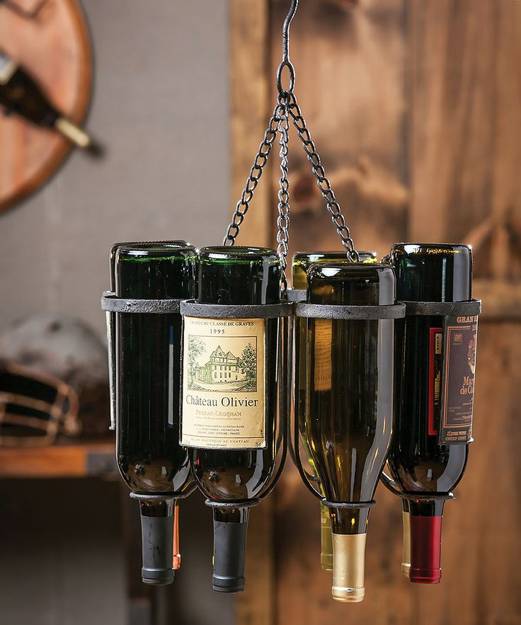 a metal hanger that holds bottles is a non traditional and bold solution that doesn't take floor space