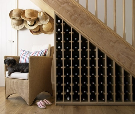 under the stairs wine bottle storage is a creative idea that doesn't take any floor space