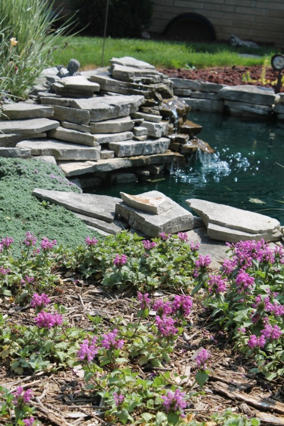 Small Pond Design With A Small Waterfall Right In The Middle Of A Garden.