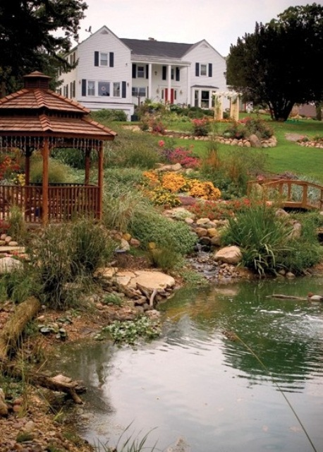 A large pond could look like a lake. Just don't forget to add a gazebo near it. It's a perfect place to admire the nature around.