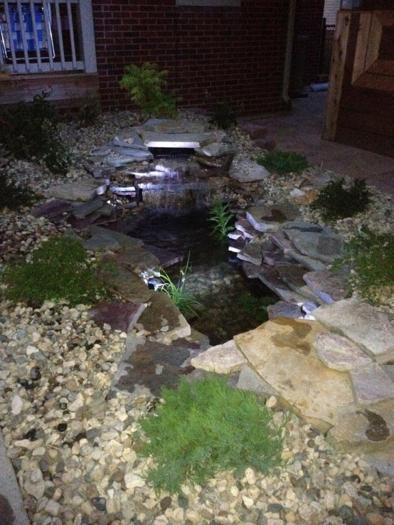 Add some under-water lighting to make your pond look better at night.