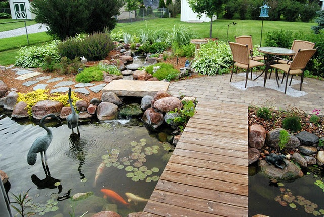 53 cool backyard pond design ideas digsdigs for Patio koi pond
