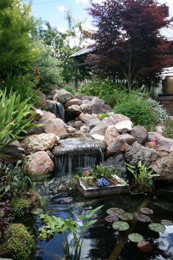 sound of flowing water could make your outdoor relaxing much more pleasant - Koi Pond Designs Ideas
