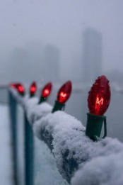 simple red bulbs attached to the railing will make your balcony fele much more festive and cool