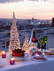 serve some champagne and desserts for only you two in the balcony and decorate the table with Christmas trees and candles