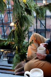 lush greenery garlands and wreaths with lights will give a fresh and natural look to your Christmas balcony