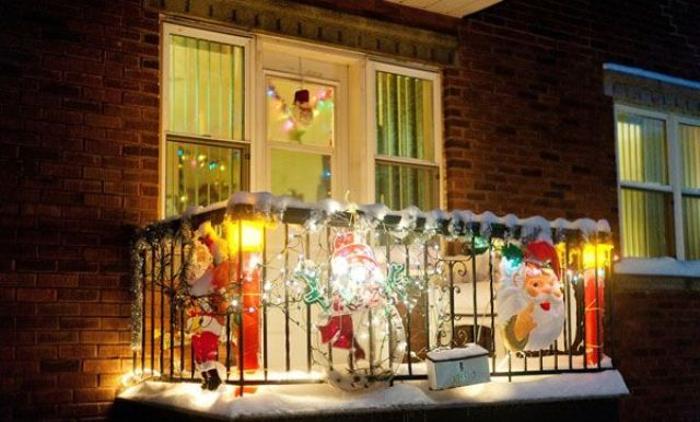 masks and Santa Claus and colorful lights make the balcony festive and bright