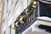 greenery garlands with large bells look very festive and bold and will instantly give a holiday feel to the space