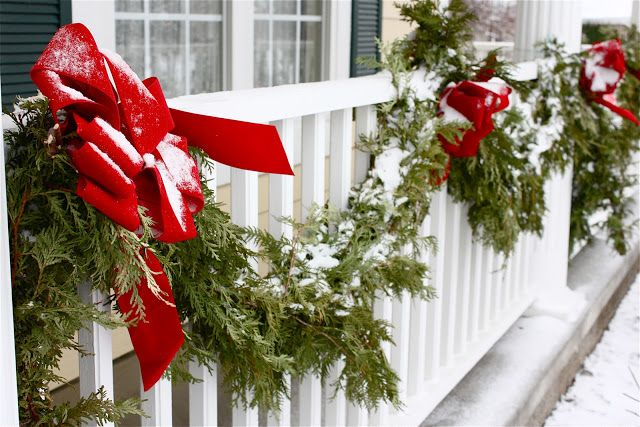 simple evergreen garlands with red bows are traditional decorations for winter and holidays, and they are easy to attach