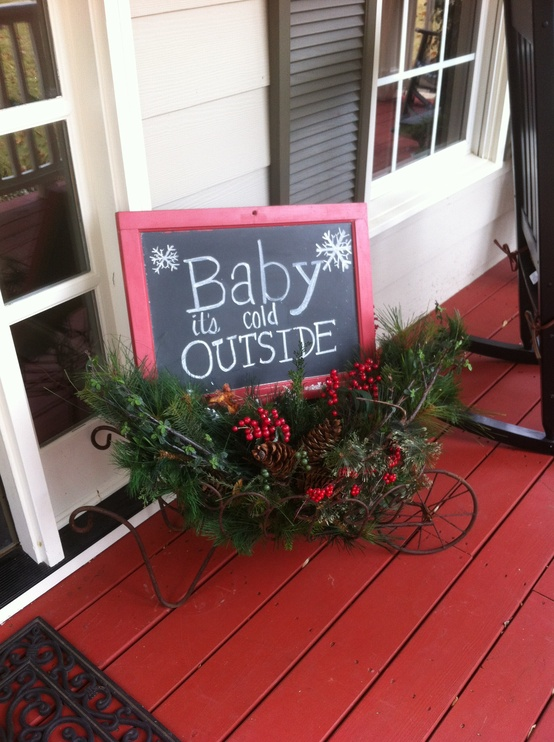 a vintage cart with a chalkboard sign, evergreens, pinecones, berries is a lovely vintage rustic decoration to rock outdoors