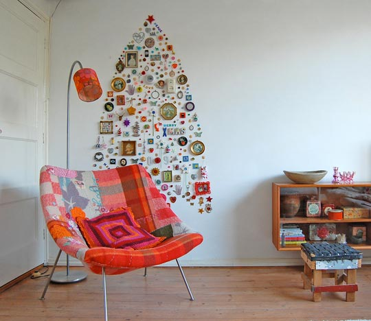Alternative Christmass Tree Of Different Things Hung On A Wall (via apartmenttherapy)