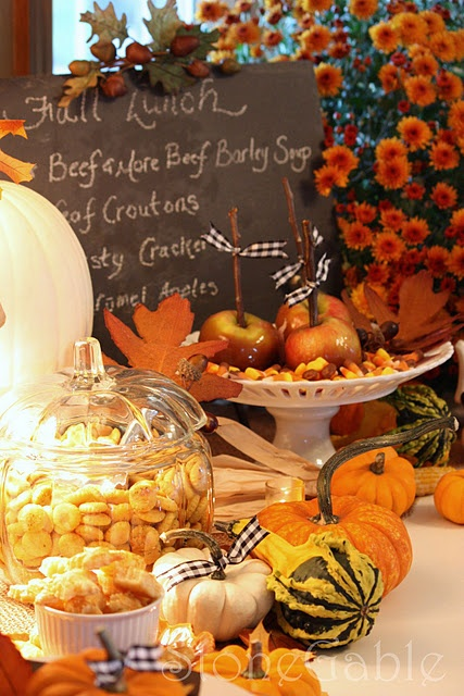 decorate your fall kitchen with bright faux pumpkins or gourds, it's a durable and non-expensive idea