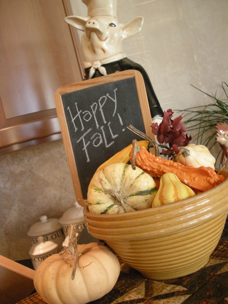 a porcelain bowl with faux gourds, pumpkins, leaves is a cool idea to add a fall feel to the space