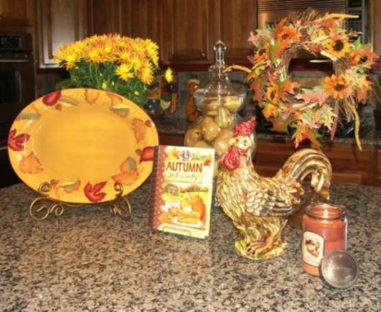a bright fall flower arrangement and a wreath of fall blooms and leaves for traditional fall kitchen decor