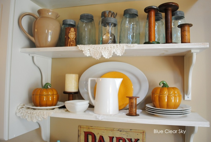 porcelain pumpkins that double as bowls with leads are a cool idea to decorate the kithen for the fall