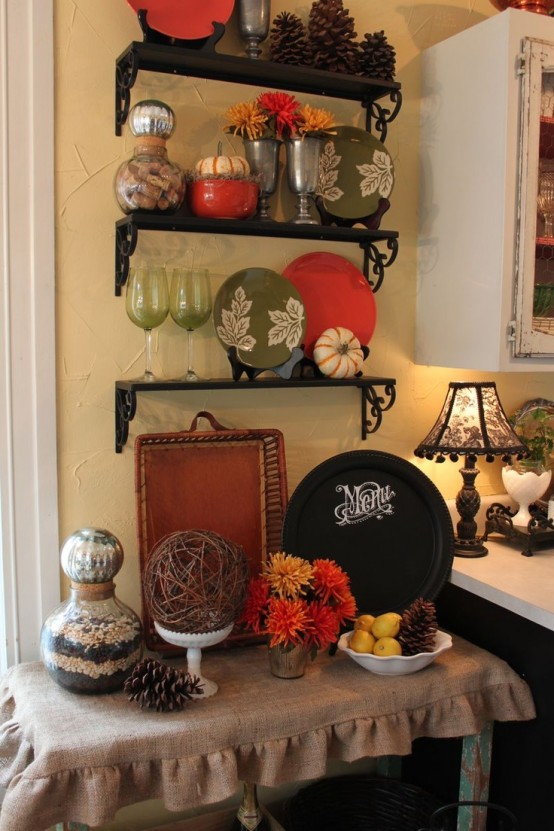 oversized pinecones, fall-colored and painted plates, bright blooms and citrus for fall kitchen decor
