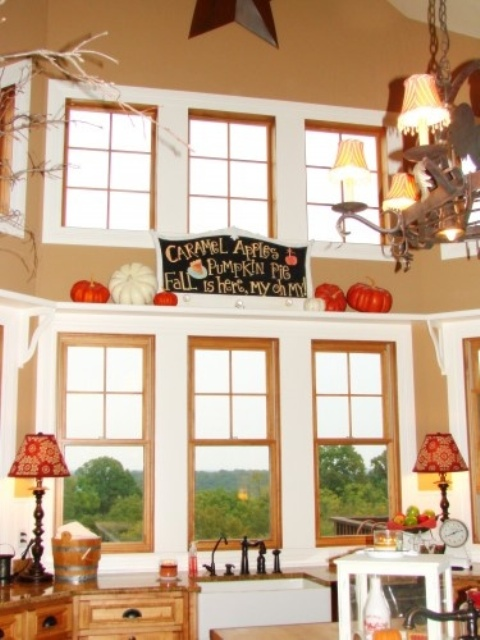 large faux pumpkins and a chalkboard sign for accenting a shelf in the kitchen