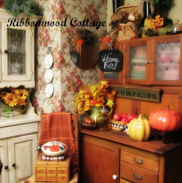 fall leaf and bloom arrangements, faux pumpkins and porcelain ones for decorating a fall kitchen or dining space