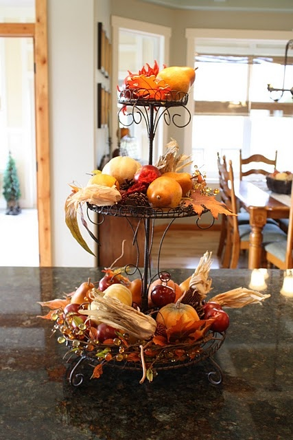 a wire stand with fall harvest and foliage is the most natural fall-like decoration for your kitchen