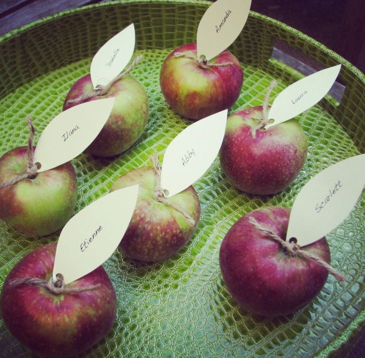 apples topped with paper leaves will be nice place cards and favors for a cool fall party