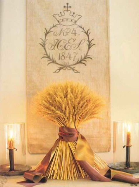 a wheat arrangement with silk ribbon can be a nice decoration or a centerpiece for a cool fall party