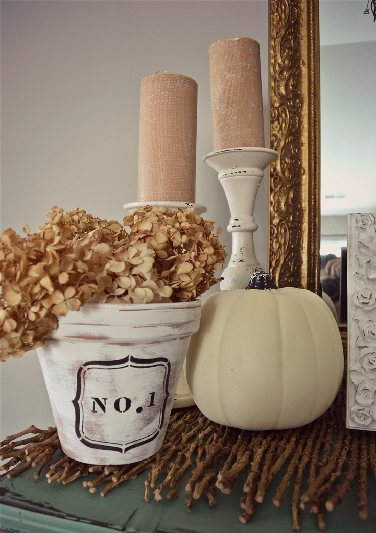 blush candles in vintage candleholders, a white pumpkin and a whitewashed pot with dried hydrangeas for a fall party