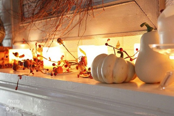 decorate the mantel with candles, white pumpkins and gourds and berries and leaves for an elegant feel
