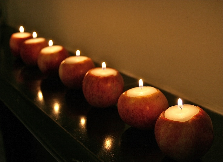 apples cut inside and with candles can become nice candleholders for a fall party or just for the fall