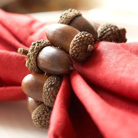 a fall napkin ring made of acorns is a cool idea to style your fall party tablescape