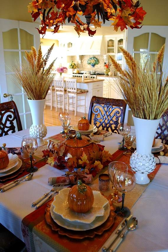a fall table done with wheat arrangements, colorful textiles, creatively shaped plates, pumpkins pots and much more