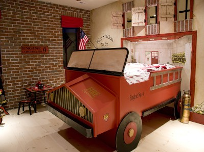 This awesome room feature a one-in-a-kind DIY firetruck bed with an awesome background.