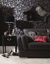 a soft Gothic liivng room with skull print wallpaper, exquisite black furniture, skull touches and shiny and glitter elements