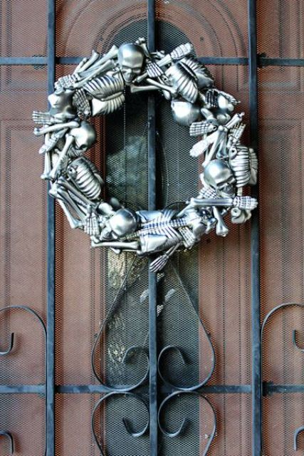 a bold metallic skeleton wreath is a gorgeous statement for Halloween, and you can DIY one easily
