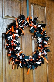 a bold Halloween wreath covered with black, white, orange and polka dot fabric pieces is a pretty solution for Halloween