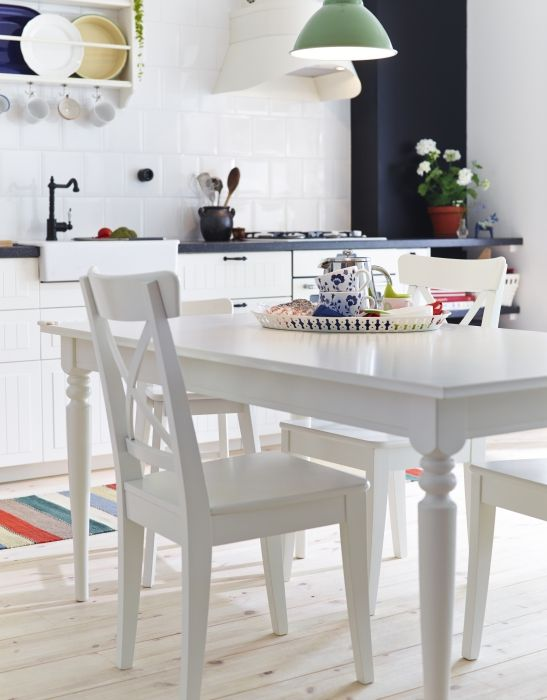 Change the legs and finish the table with glossy white paint for a modern dining room.