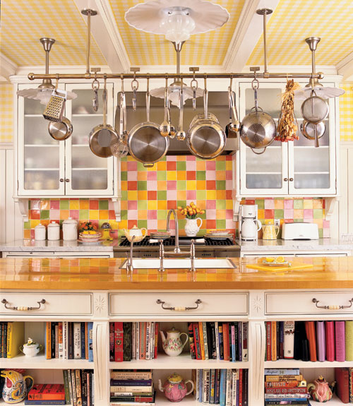 a holder over the kitchen island is great for hanging pans and pots and you will save a lot of shelf space