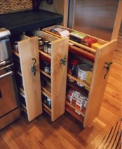 a small cabinet can hold several vertical drawers to store more stuff, which is great for a small kitchen