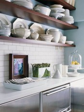 long open shelves attached to the wall over the cabinets are great for storing tableware and various stuff for cooking
