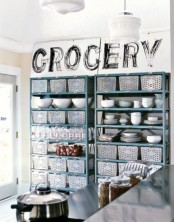 large open storage shelves completed with several boxes to store food and other things are perfect for kitchens