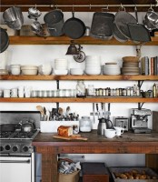 super long open shelves for storing al the tableware and a rail for hanging pots, pans and other things